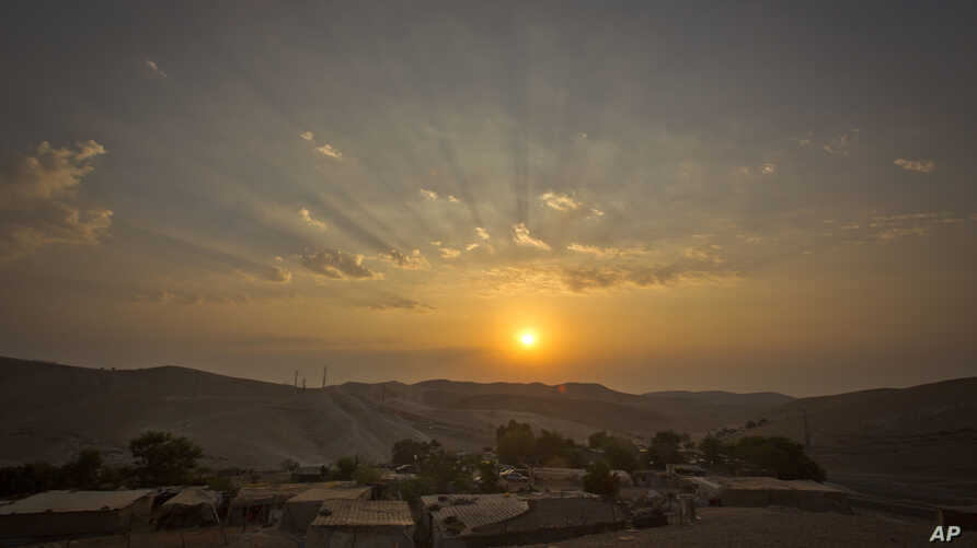 The sun rises over West Bank hamlet of Khan al-Ahmar, Sept. 13, 2018. The Palestinian residents of Khan al-Ahmar cling to hopes that international pressure can save their strategically located West Bank hamlet from Israeli army bulldozers.