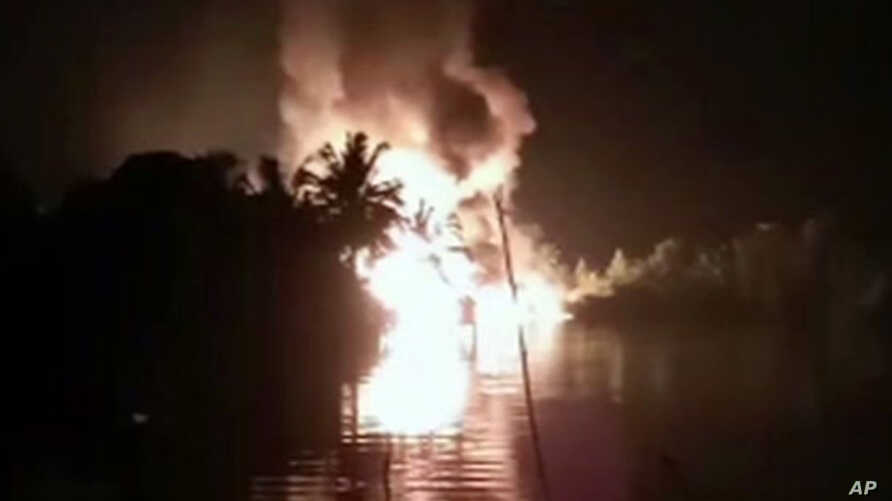 In this image made from video March 1, 2019, fire is seen from a pipeline explosion in Nembe, Nigeria.