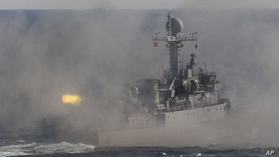 FILE- A South Korean navy patrol boat fires during an exercise off South Korea's southeastern coast near Busan, South Korea.