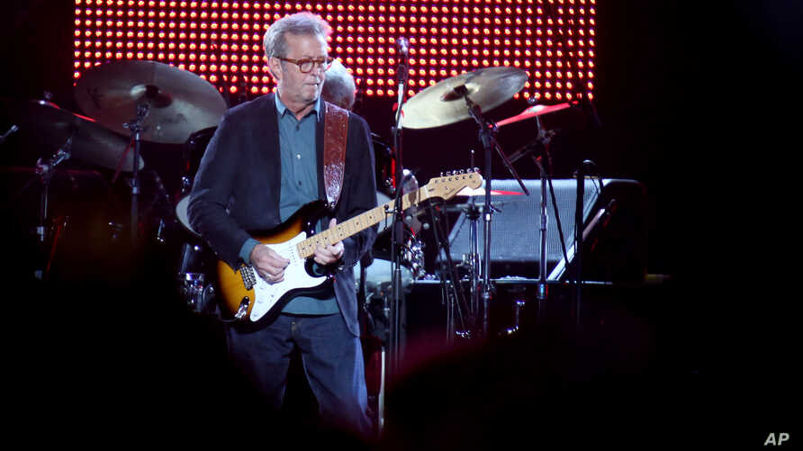 "FILE - Eric Clapton, center, performs during his ""70th Birthday Celebration"" concert at Madison Square Garden on Friday, May 1, 2015, in New York."