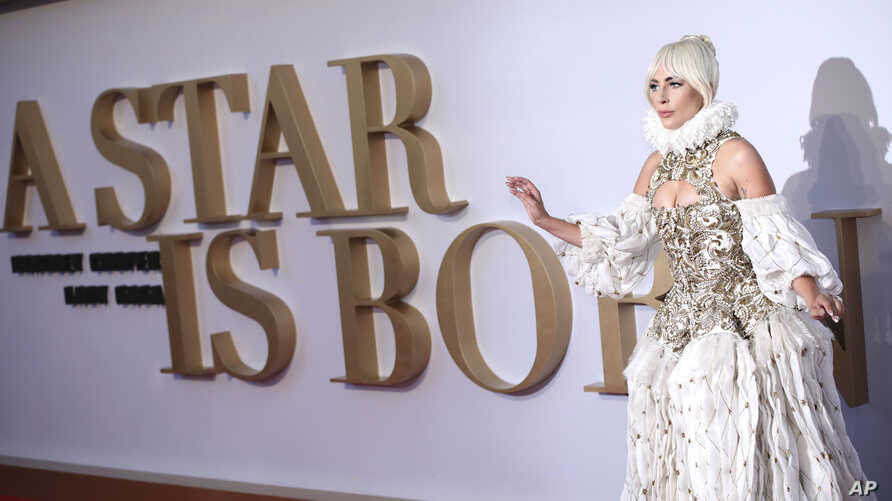 """Actress and singer Lady Gaga poses for photographers upon arrival at the premiere of the film """"A Star Is Born"""" in London, Sept. 27, 2018."""