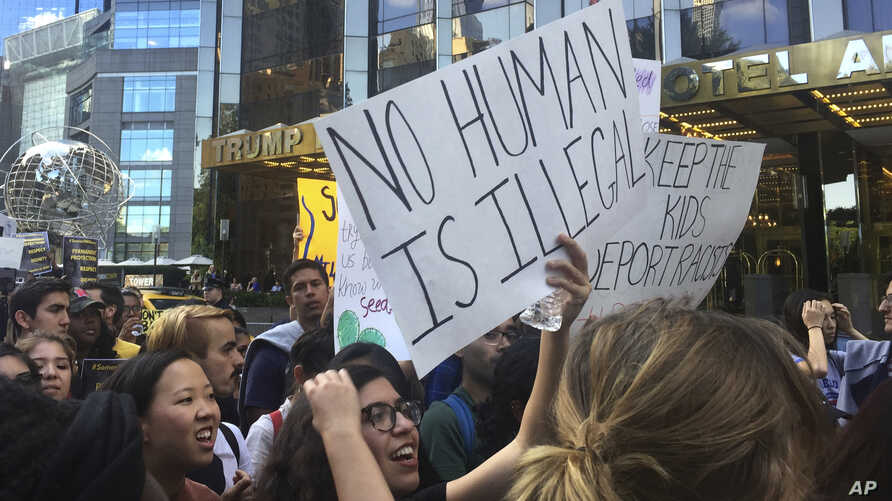 Protesters rally outside the Trump International Hotel and Tower in New York to protest the Trump administration's decision to end a program protecting young immigrants from deportation, Sept. 9, 2017. Many people attending the rally said the program