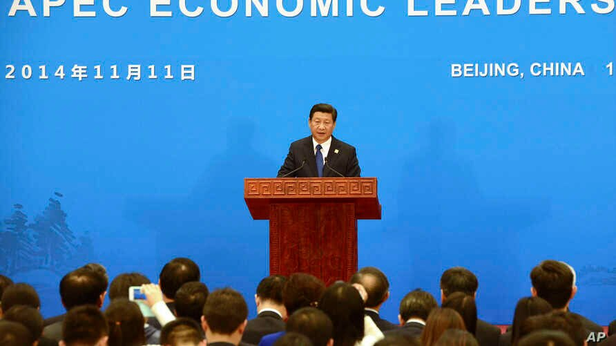 China's President Xi Jinping speaks during a press conference to close the Asia-Pacific Economic Cooperation (APEC) Summit at the International Conference Center in Yanqi Lake, north of Beijing, Nov. 11, 2014.
