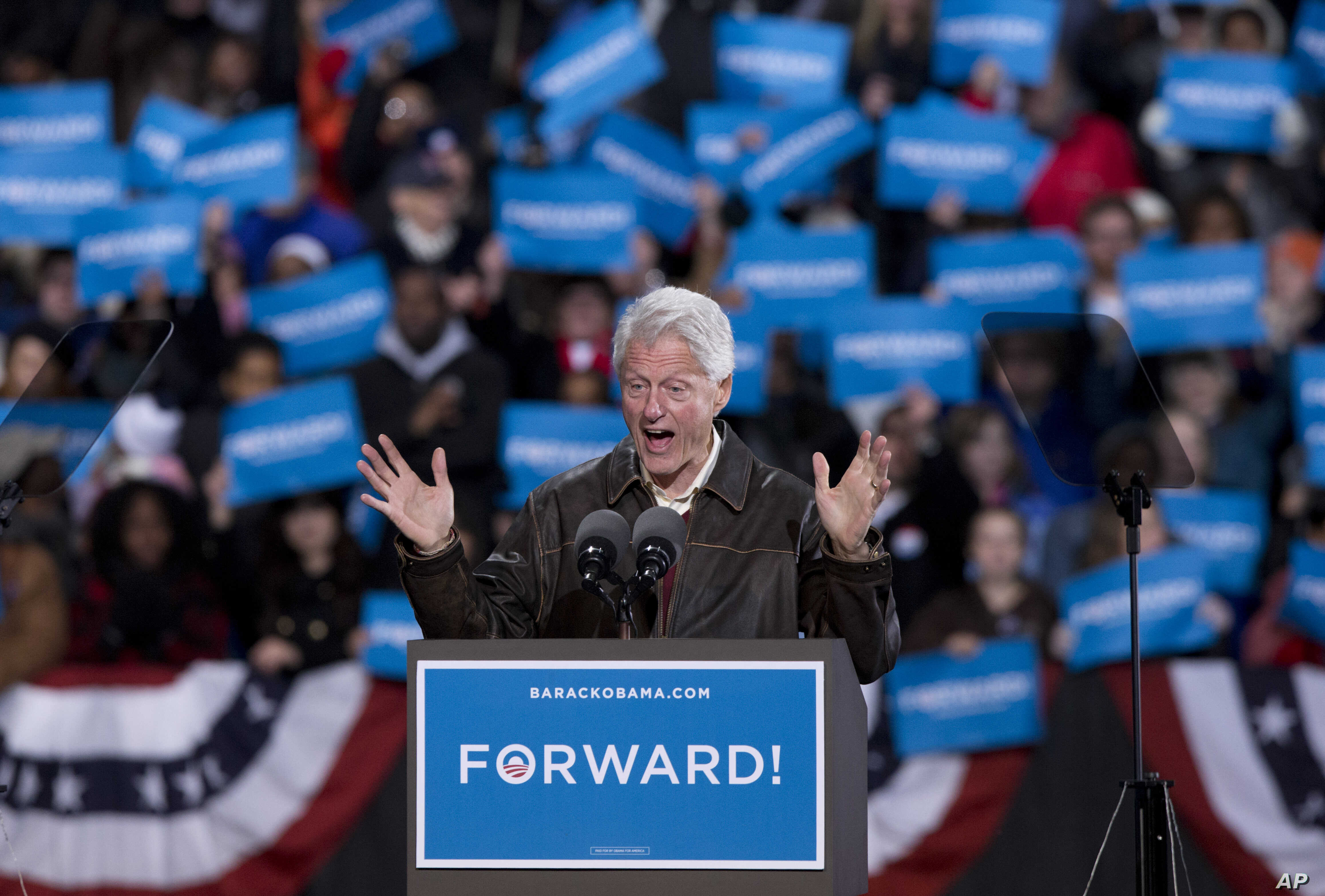In the final hours of a four-state campaign day, President Barack Obama is introduced by former President Bill Clinton at a rally at Jiffy Lube Live arena, November 3, 2012, in Bristow, Virginia.