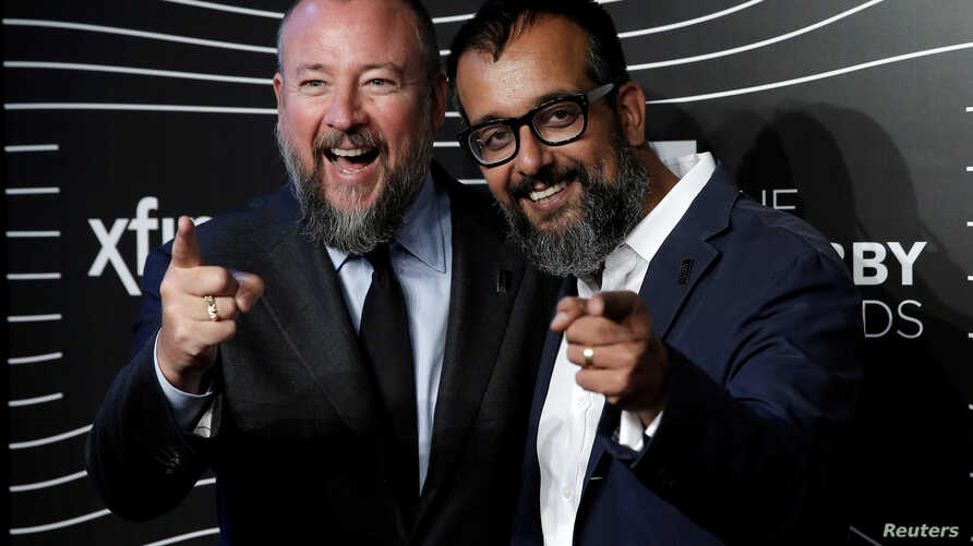 FILE - Vice Media co-founders Shane Smith, left, and Suroosh Alvi pose at the 20th Annual Webby Awards in Manhattan, New York, May 16, 2016.