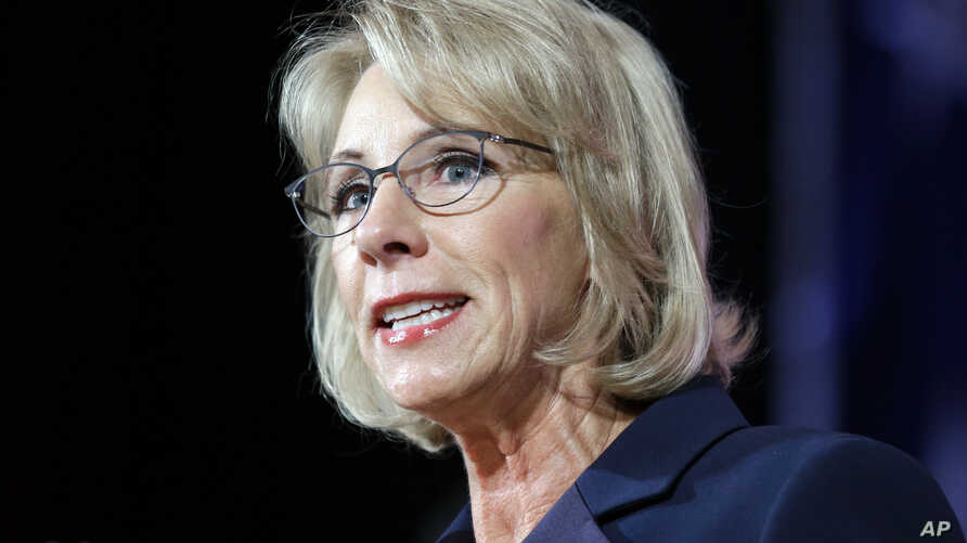 FILE -  Education Secretary Betsy DeVos speaks during a dinner hosted by the Washington Policy Center in Bellevue, Wash., Oct. 13, 2017.