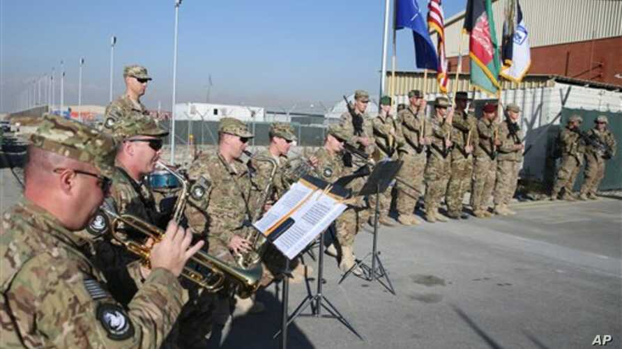 The International Security Assistance Forces band plays during flag-lowering ceremony in Kabul as U.S., NATO forces ceremonially end their 13 year combat mission in Afghanistan, Dec. 8, 2014.