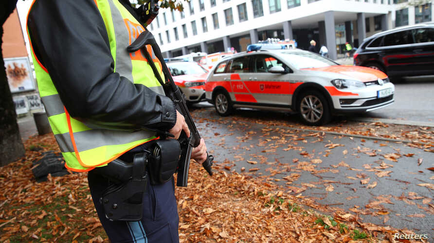 A German police officer guards the site where earlier a man injured several people in a knife attack in Munich, Germany, Oct. 21, 2017.