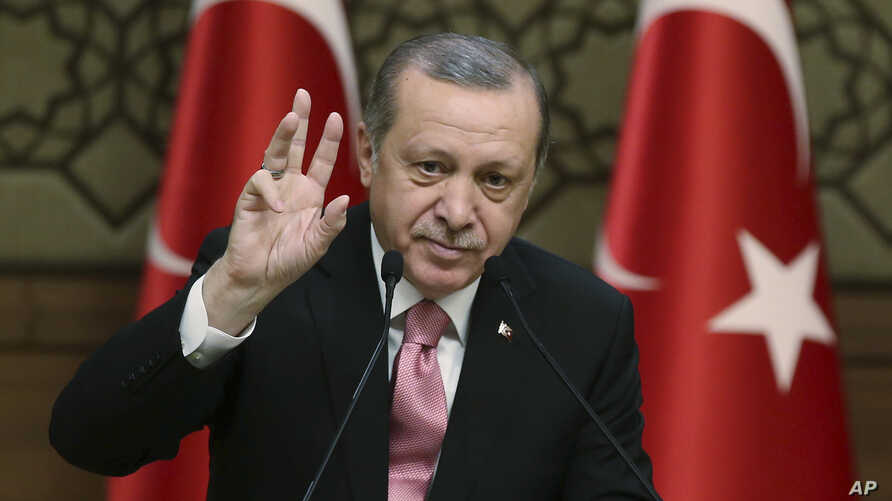 "Turkey's President Recep Tayyip Erdogan gestures as he addresses local administrators, in Ankara, Turkey, Wednesday, Feb. 8, 2017. In a sign of ameliorating ties, Turkish officials said Wednesday that U.S. President Donald Trump looked ""positively"" o"