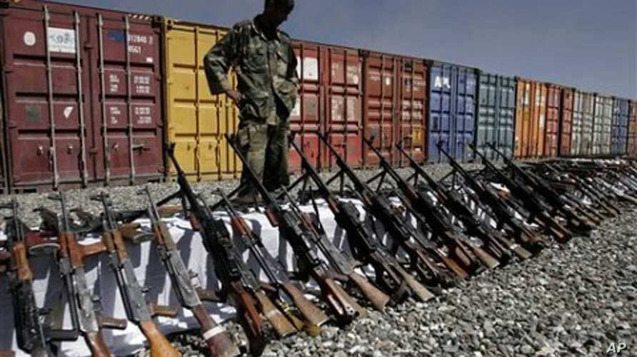 An Afghan policeman looks at weapons confiscated from private security companies, in Kabul, Afghanistan (File Photo - 05 Oct 2010)