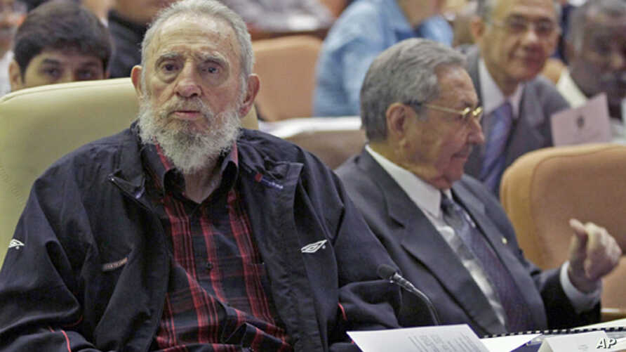 Cuba's leader Fidel Castro (l) and his brother President Raul Castro attend the opening session of the National Assembly in Havana,  Feb. 24, 2012.