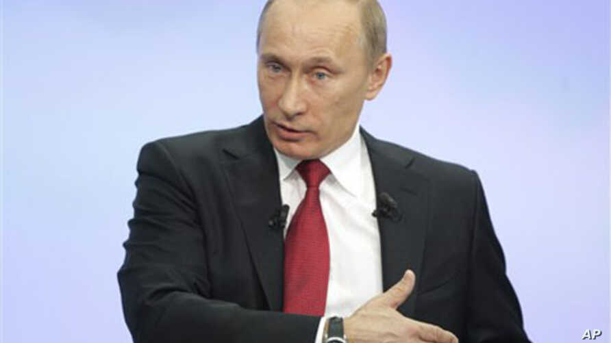 Russia's Prime Minister Vladimir Putin during a call-in session broadcast live on Russian state television and radio in Moscow, 16 Dec 2010