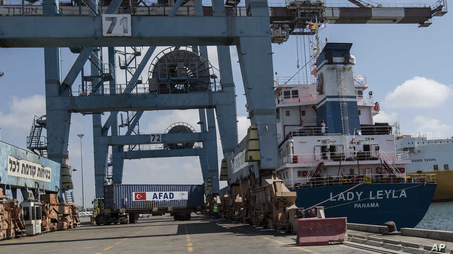 "Containers are unloaded from Panama-flagged ""Lady Leyla"", a ship carrying Turkish humanitarian aid to Gaza, arrives at the port in the city of Ashdod, Israel, July 3, 2016. T"