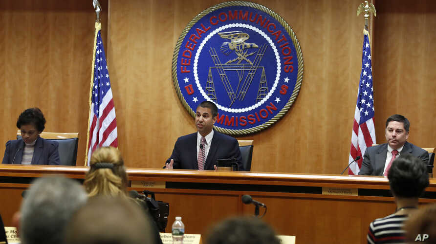 Federal Communications Commission (FCC) Chairman Ajit Pai, center, announces the vote was approved to repeal net neutrality, next to Commissioner Mignon Clyburn, left, who voted no, and Commissioner Michael O'Rielly, who voted yes, at the FCC, Dec. 1