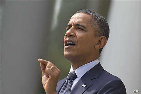 President Barack Obama gestures while speaking in the Rose Garden of the White House in Washington, DC, September 19, 2011.