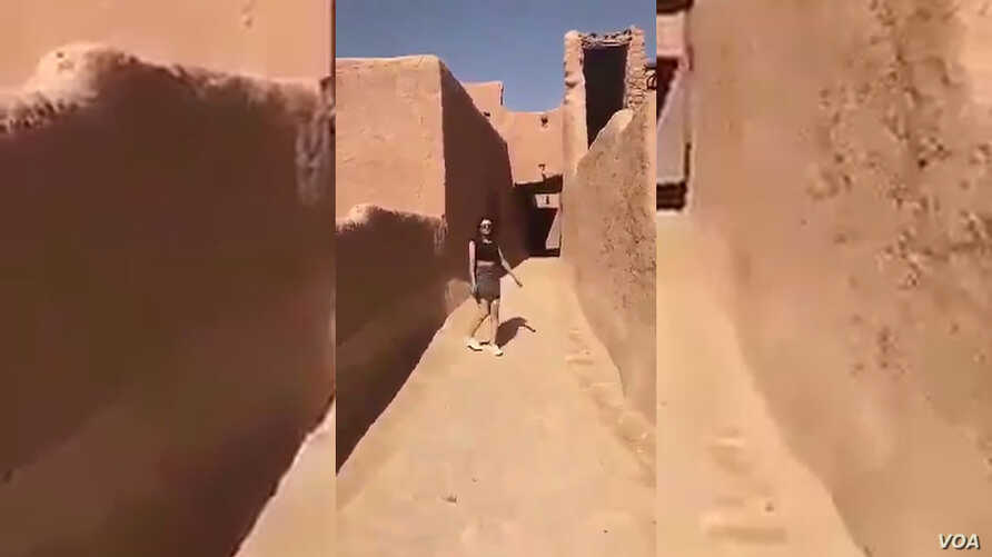 This screen grab of a video posted online purports to show a woman wearing a miniskirt and crop top at a historic fort in Ushaiager, Saudi Arabia.