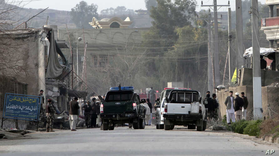 Security officials, investigates the scene of a suicide car bomb attack which killed and injured several people at the National Directorate of Security in Jalalabad, Afghanistan, February 24, 2013.