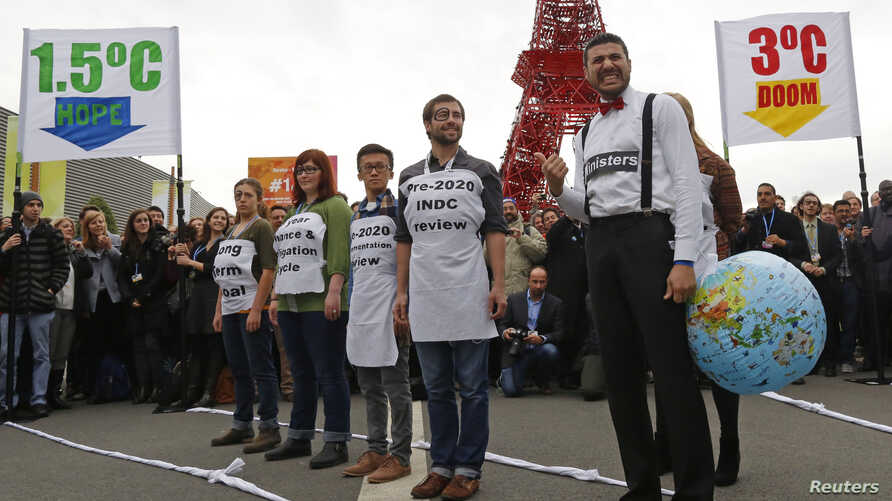People demonstrate during the World Climate Change Conference 2015 (COP21) at Le Bourget, near Paris, France, Dec. 8, 2015.
