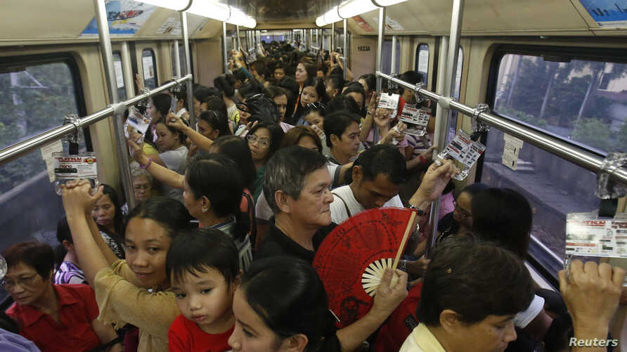 Commuters ride a train during rush hour on Southeast Asia's first light rail transit network, which is 29-years-old, in Manila, Oct. 10, 2013. The Philippines is about to spend $169 billion on infrastructure, including railways and an airport termina