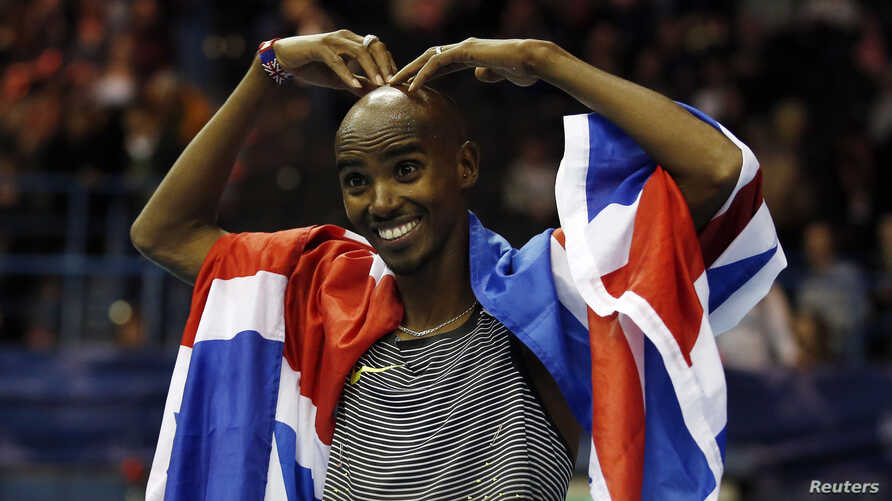 FILE - Britain's Mo Farah celebrates winning the Men's 5000m Action at the Birmingham Indoor Grand Prix, Barclaycard Arena, Feb. 18, 2017.