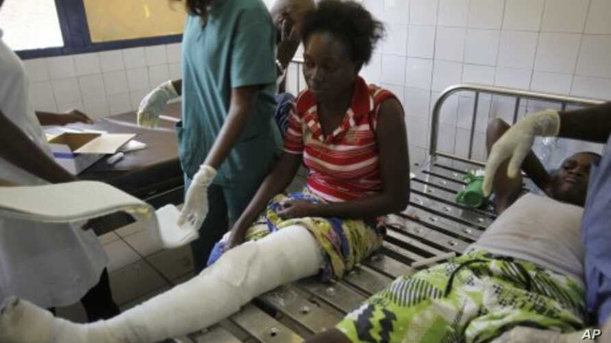 A woman is treated at the central hospital after a series of explosions destroyed homes and buildings in the Mpila neighborhood of Congo Republic's capital Brazzaville, March 5, 2012.