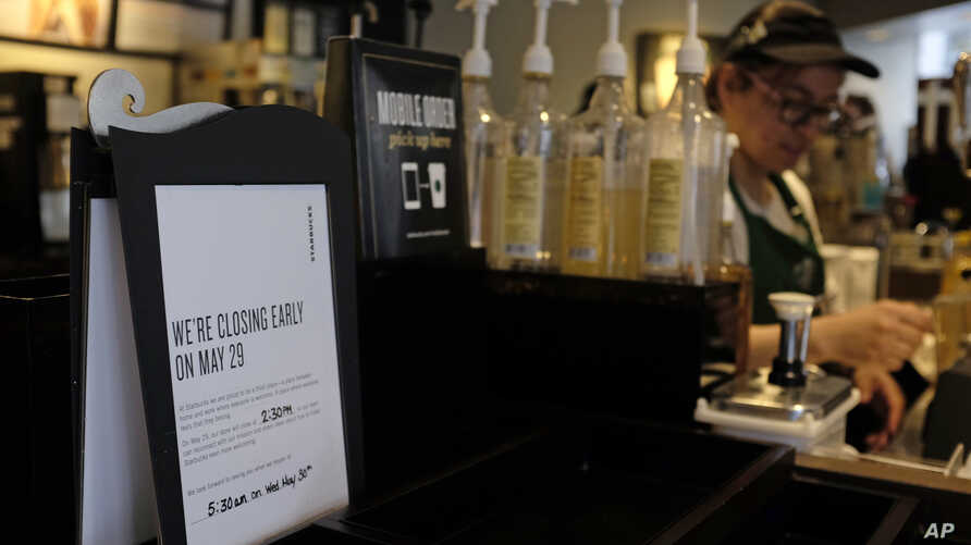 "A ""store closing early"" sign for May 29 is posted at a pickup counter at a Starbucks location, May 25, 2018, in Chicago, Illinois."