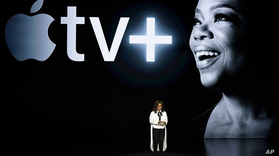 FILE - Oprah Winfrey speaks at the Steve Jobs Theater during an event to announce new Apple products, in Cupertino, California, March 25, 2019.