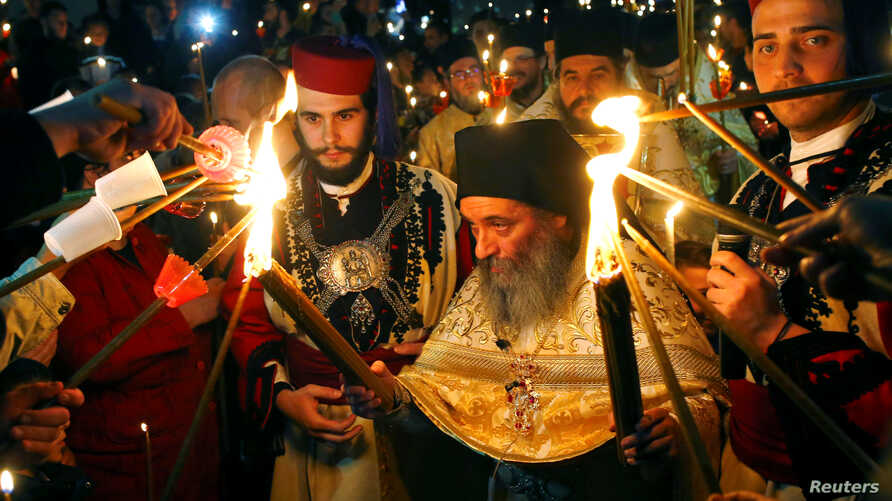 Priests lead the Christian Orthodox Easter service at the 10th century St. John the Baptist Monastery near Mavrovo, west of Macedonia's capital Skopje, April 16, 2017.