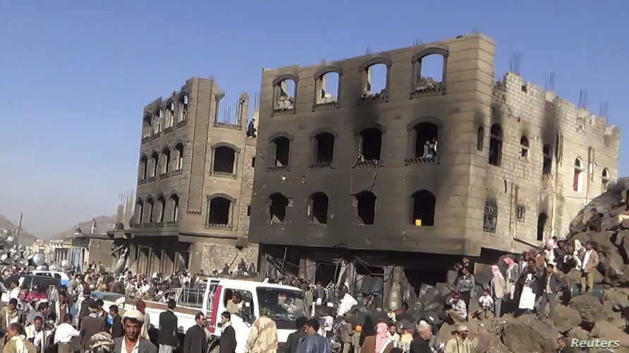 FILE - People gather at the site of an airstrike by the Saudi-led coaltion in Yareem city in Ibb province, Yemen, March 31, 2015.