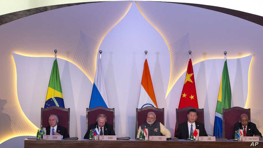 Leaders of BRICS nations, from left, Brazilian President Michel Temer, Russian President Vladimir Putin, Indian Prime Minister Narendra Modi, Chinese President Xi Jinping and South African President Jacob Zuma listen to the BRICS Business Council rep