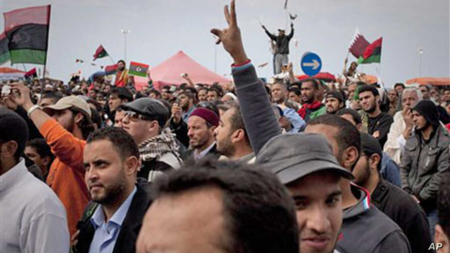 Libyan people celebrate in the main square of Benghazi, eastern Libya, March 18, 2011
