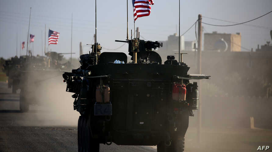 A convoy of U.S. forces armored vehicles drives near the village of Yalanli, on the western outskirts of the northern Syrian city of Manbij, March 5, 2017.