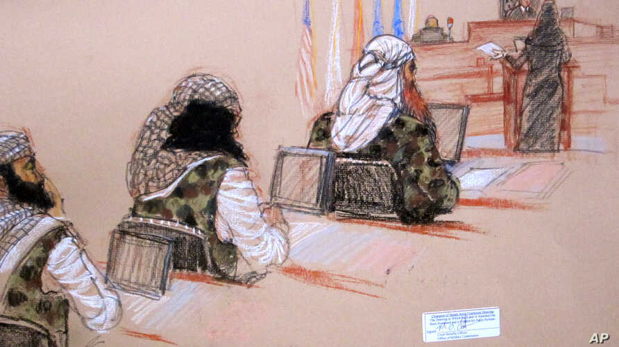 In this pool photo of a sketch by courtroom artist Janet Hamlin and reviewed by the U.S. Department of Defense, three of the five Sept. 11 defendants, from left, Ramzi Binalshibh, Walid bin Attash and the self-proclaimed terrorist mastermind Khalid S