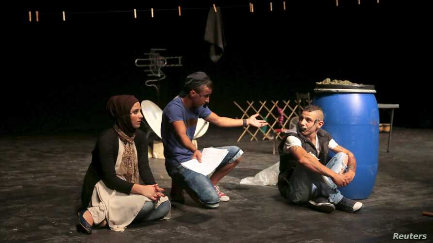 """Youths from Tripoli, north Lebanon, perform in the play, """"Love and War on the Rooftops,"""" in Beirut, Lebanon, July 28, 2015."""