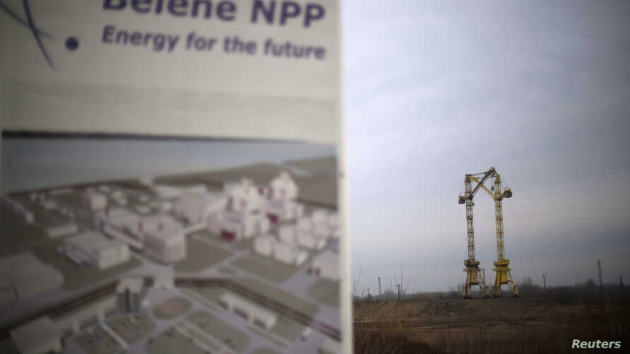 FILE - Cranes are seen in the background at the construction site of Bulgaria's second nuclear power plant in Belene, some 230 km (143 miles) north of Sofia, Jan. 24, 2013.