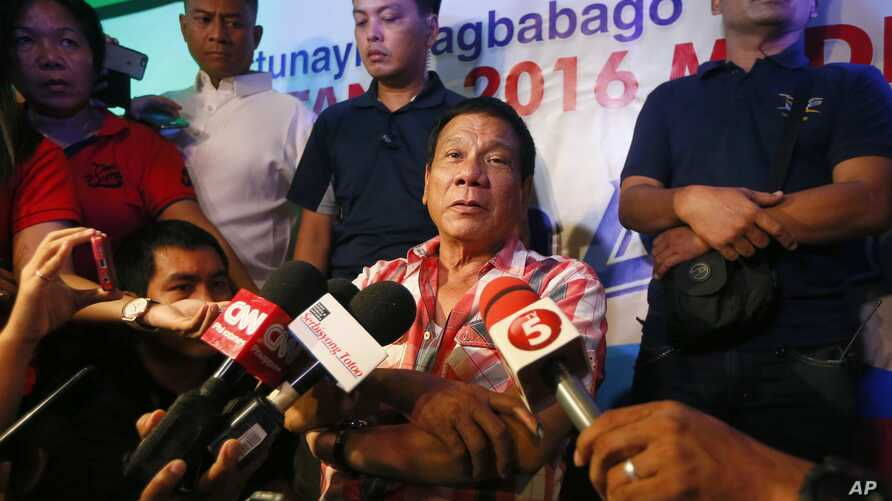 Front-running presidential candidate Mayor Rodrigo Duterte is interviewed by the media shortly after voting in a polling precinct at Daniel R. Aguinaldo National High School, Matina district, his hometown in Davao city in southern Philippines, May 9,
