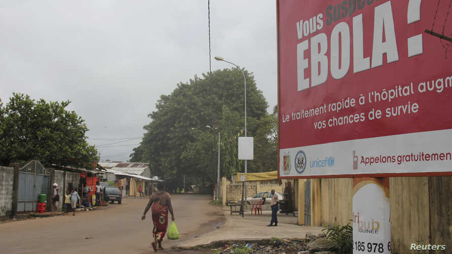 A billboard with a message about Ebola is seen on a street in Conakry, Guinea Oct. 26, 2014.