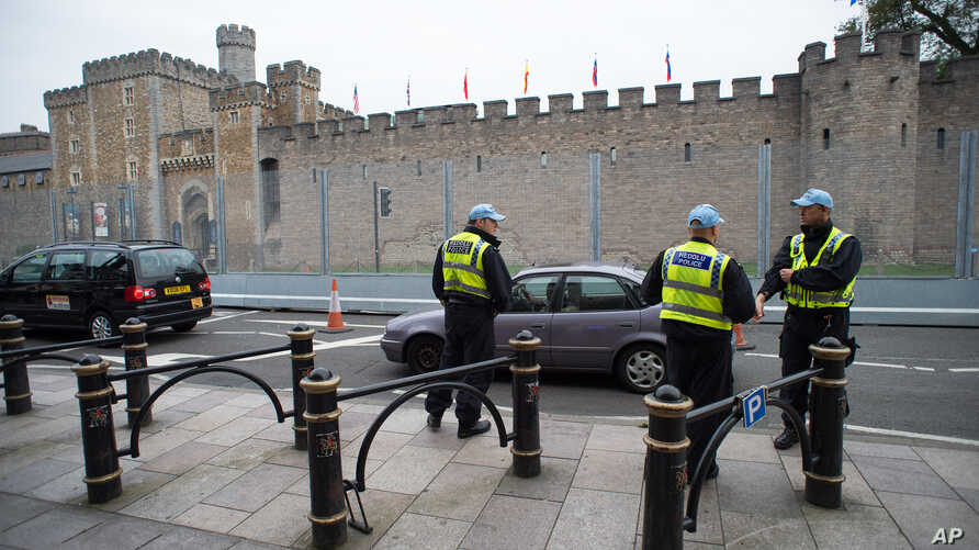 Security fencing and police outside Cardiff Castle ahead of the UK-based NATO summit, in Cardiff, Wales, Sept. 3, 2014.