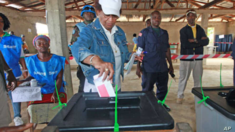 Nobel Peace Prize Laureate Ellen Johnson Sirleaf, who is also Liberia's president and presidential candidate of the Unity Party, votes at a polling station in Feefee in Bomi County, Liberia, October 11, 2011.