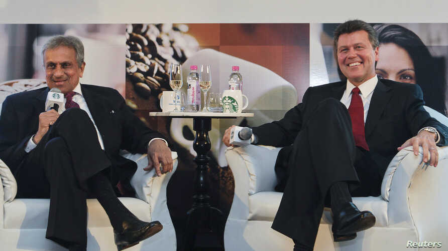 Vice Chairman of Tata Global Beverages R.K. Krishna Kumar and President of Starbucks China and Asia Pacific John Culver (R) attend a news conference in Mumbai, January 30, 2012.