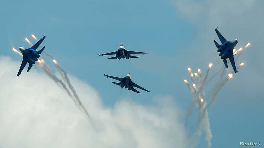 FILE: Sukhoi Su-27 jet fighters of the Russkiye Vityazi (Russian Knights) aerobatic team fly in formation during the International Army Games 2016, in Dubrovichi outside Ryazan, Russia, August 5, 2016.