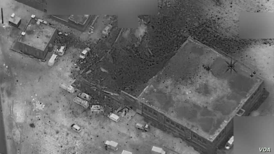 The site of an al-Qaida senior leader meeting in al-Jinah, Syria, is shown after being hit by an airstrike March 16. The photo shows what appears to be an intact, undamaged mosque next to a larger building that apparently suffered multiple weapons st