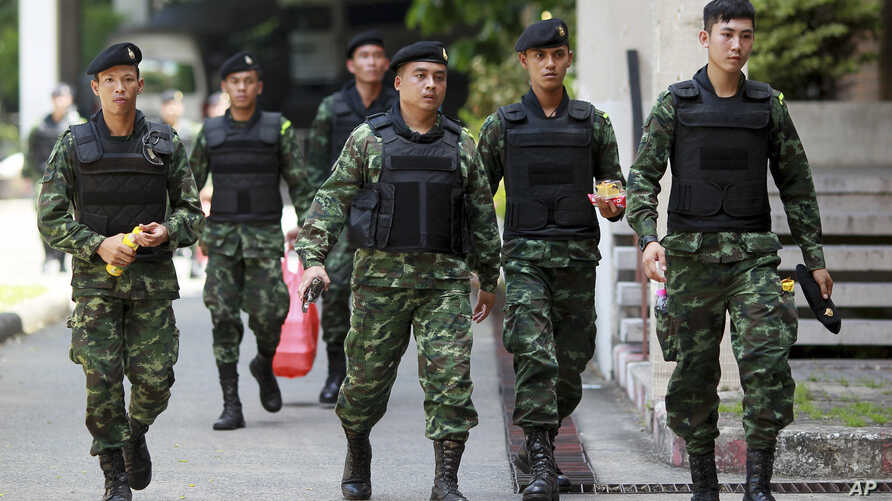 FILE - Thai soldiers walk after being deployed to guard at Bangkok's Victory Monument, Thailand, June 8, 2014.