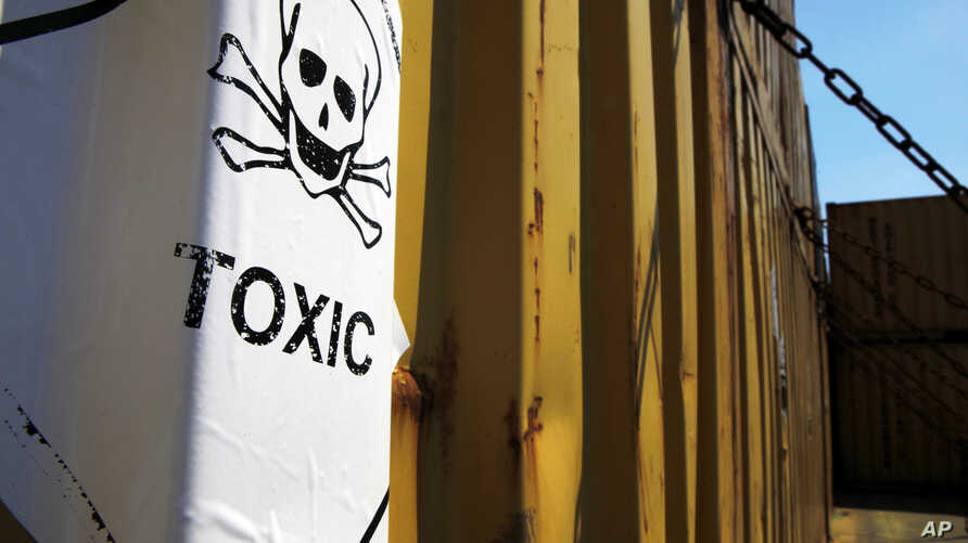 FILE - A sticker reading Toxic on containers carrying Syria's dangerous chemical weapons, on the Danish cargo ship, Ark Futura, transporting the chemical weapons out of the strife-torn country, in Cyprus coastal waters.