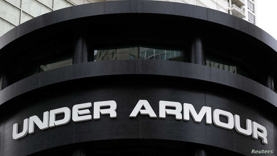 FILE - An Under Armour sign is seen outside a store in Chicago, Oct. 25, 2016.  Under Armour said March 29, 2018, that it was working with data security firms and law enforcement in the wake of a data breach affecting 150 million MyFitnessPal diet an