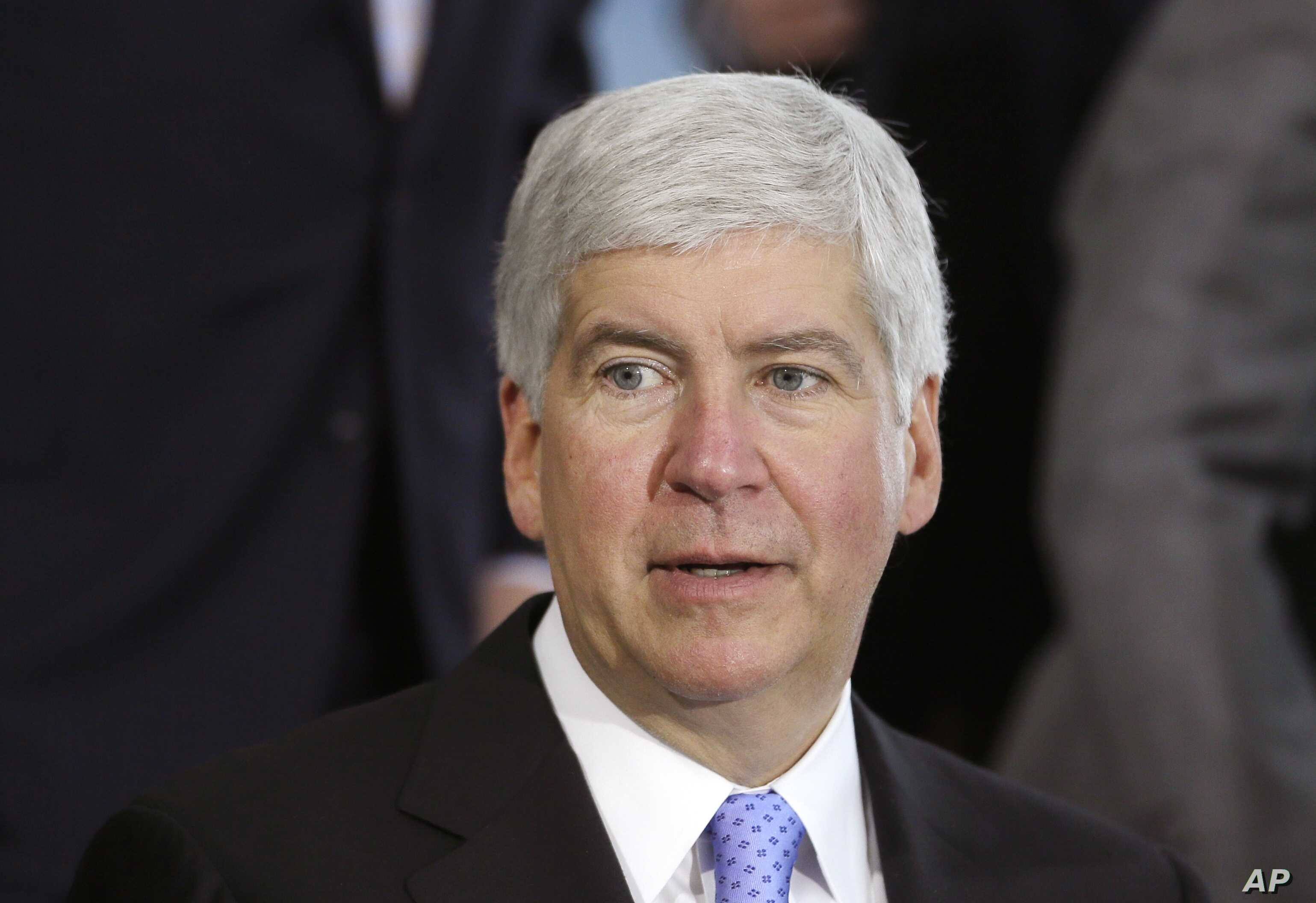 FILE - Michigan Gov. Rick Snyder speaks in Detroit. Snyder is under fire, accused of reacting too slowly to the water crisis in Flint.