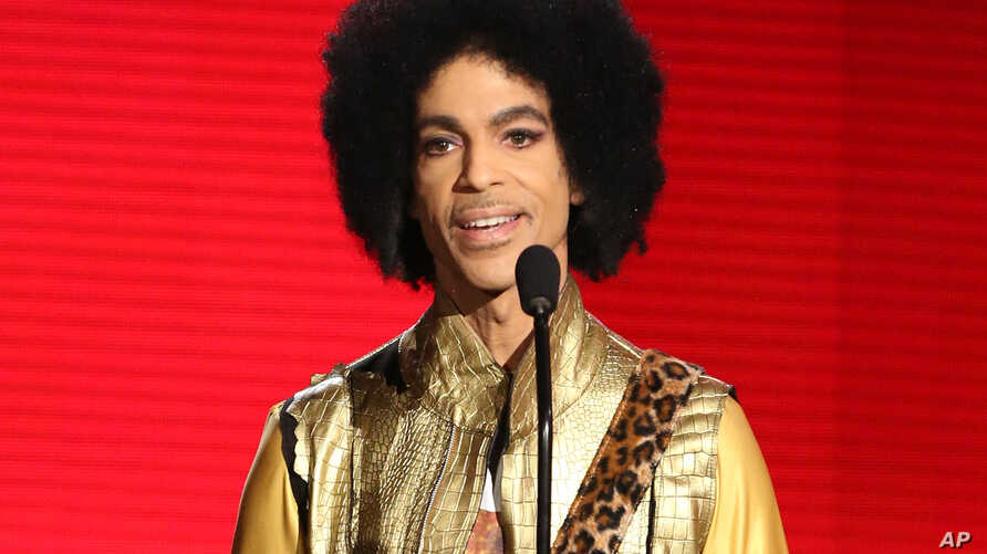 FILE - In this Nov. 22, 2015 file photo, Prince presents the award for favorite album - soul/R&B at the American Music Awards in Los Angeles.