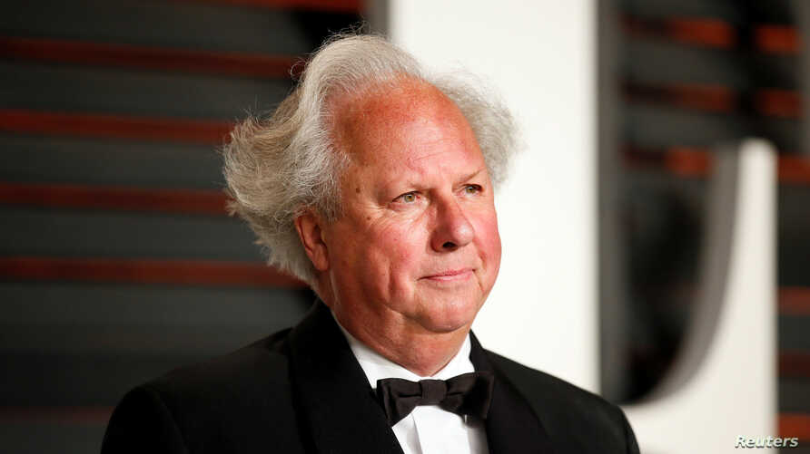 FILE- Editor and Chief of Vanity Fair Graydon Carter arrives at the 2015 Vanity Fair Oscar Party in Beverly Hills, California, Feb. 22, 2015.