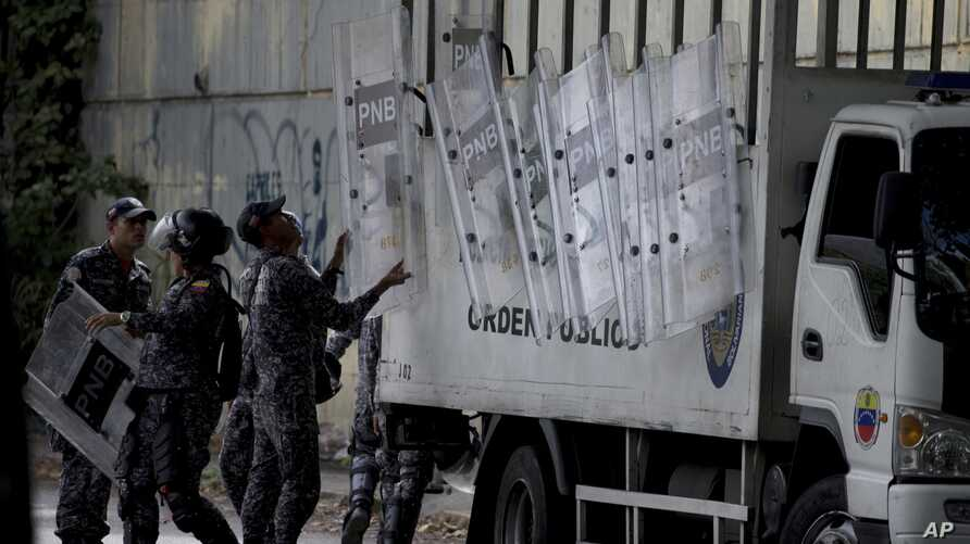 Venezuelan police set up a check-point outside the morgue, where the body of the late rebel police officer Oscar Perez is being held in Caracas, Venezuela, Jan. 17, 2018.