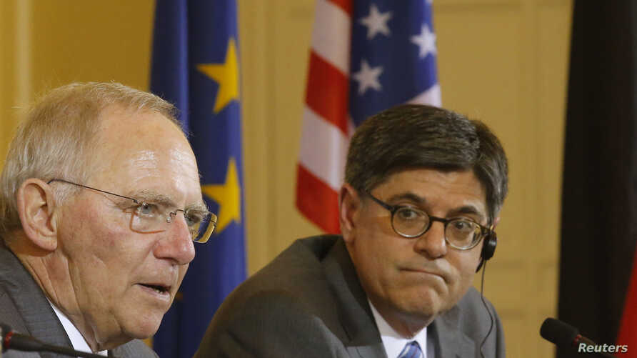 German Finance Minister Wolfgang Schaeuble (L) and U.S. Treasury Secretary Jack Lew address a news conference after talks in Berlin Apr. 9, 2013.